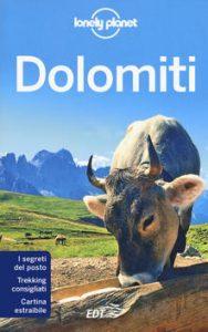 libro sulle dolomiti con una mucca in copertina